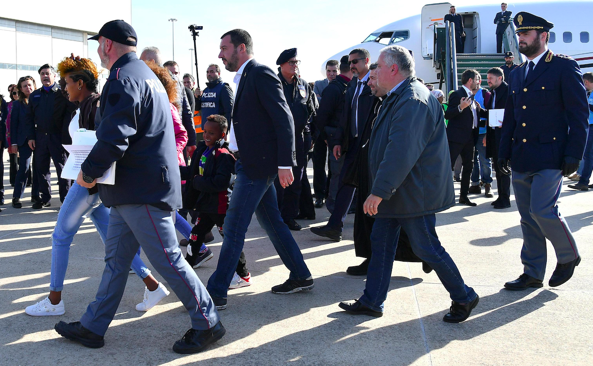 Italian Deputy Prime Minister and Interior Minister, Matteo Salvini (C) is seen upon the arrival of 51 migrants coming from reception centers in Niger and identified by the UNHCR (United Nations High Commissioner for Refugees), at the airport of Pratica di Mare, near Rome, Italy, 14 November 2018. According to reports, the migrants, who were taken away from Libyan prisons by the UNHCR and evacuated to a transit center in Niger, arrived on the day to Italy, which is waiting for other European countries to give the availability to accept a quota. ANSA/ETTORE FERRARI