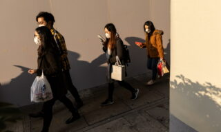 epa08223554 Pedestrians wear face masks in Hong Kong, China, 17 February 2020. As of 17 February, the number of those infected by the coronavirus that causes the disease known as Covid-19, also known as coronavirus, grew to 59 in Hong Kong. More than 70,000 people have been infected in mainland China with the death toll at 1,770.  EPA/JEROME FAVRE