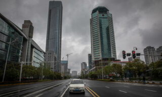 A car waits for a traffic light on an almost empty road in Wuhan, China, 29 March 2020. Wuhan, the epicenter of the coronavirus outbreak, partly lifted the lockdown allowing people to enter the city after more than two months. Chinese authorities eased the quarantine measures as cases of Covid-19 across China have plummeted, according to Chinese government reports. EPA/ROMAN PILIPEY