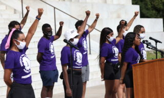 epa08632306 Organizers for the March on New York City speak during the March on Washington at the Lincoln Memorial in Washington, DC, 28 August 2020. 28 August 2020 marks the 57th anniversary of Rev. Martin Luther King Jr.'s I Have A Dream speech at the same location.  EPA/Michael M. Santiago / POOL
