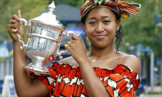 epa08666559 Naomi Osaka of Japan poses with the Championship Trophy on the grounds of the US Open Tennis Championships at the USTA National Tennis Center in Flushing Meadows, New York, USA, 13 September 2020. Due to the coronavirus pandemic, the US Open is being played without fans and runs from 31 August through 13 September.  EPA/JASON SZENES