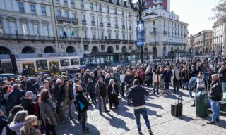 A moment of the no-masks and Covid-19 negationists manifestation in Castello square, Turin, Italy, 20 March 2021.  ANSA/TINO ROMANO