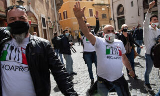 Street traders protest at Montecitorio Square front Italian Parlament in Rome, Italy, 06 April 2021. They ask to be allowed to reopen and obtain immediate economic helps amid the third Covid-19 wave in Italy. ANSA/MAURIZIO BRAMBATTI