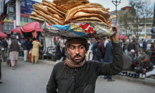 epa09131372 An Afghan boy sells bread in downtown Kabul, ahead of the holy month of Ramadan during coronavirus pandemic in Kabul, Afghanistan, 12 April 2021. Muslims around the world celebrate the holy month of Ramadan by praying during the night time and abstaining from eating, drinking, and sexual acts during the period between sunrise and sunset. Ramadan is the ninth month in the Islamic calendar and it is believed that the revelation of the first verse in Koran was during its last 10 nights.  EPA/HEDAYATULLAH AMID