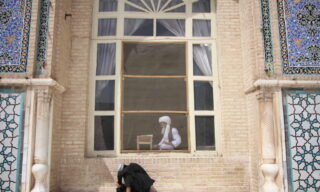 epa09132594 A Muslim man reads the holy Koran at a Mosque during the holy month of Ramadan in Herat, Afghanistan, 13 April 2021. Muslims began observing the dawn-to-dusk fast for the holy month of Ramadan across many parts of the Middle East on Tuesday 13 April. to draw worshippers closer to God through sacrifice, remembrance and heightened spirituality.  EPA/JALIL REZAYEE