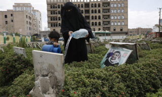 epa09132788 A Yemeni woman pours water on the grave of her relative on the first day of the holy month of Ramadan, at a cemetery in Sana'a, Yemen, 13 April 2021. Muslims around the world celebrate the holy month of Ramadan by praying during the night time and abstaining from eating, drinking, and sexual acts during the period between sunrise and sunset. Ramadan is the ninth month in the Islamic calendar and it is believed that the revelation of the first verse in Koran was during its last 10 nights.  EPA/YAHYA ARHAB