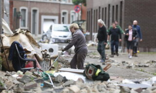 epa09347981 Residents clean up houses after heavy rains had caused severe flooding in Ensival, Verviers, Belgium, 16 July 2021. Heavy rains have caused widespread damage and flooding in parts of Belgium.  EPA/STEPHANIE LECOCQ
