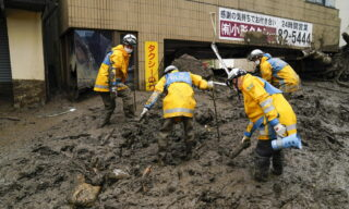 epa09323421 Tokyo Metropolitan Police Department rescue workers are searching for missing people on the mudslide triggered by torrential rain at hot-spring resort area Izusan in Atami, Shizuoka Prefecture, central Japan, 05 July 2021, while about 1,000 rescue workers are deployed on the day. Atami Mayor announced in the morning of 05 July 2021 the city has not confirmed about 100 people's safety yet after the city has announced about 20 people are missing since 03 July 2021 after the mudslide. Japanese news agency Jiji Press has reported city officials try to confirm safety of 80 people. Three people were confirmed dead by the mudslide.  EPA/KIMIMASA MAYAMA